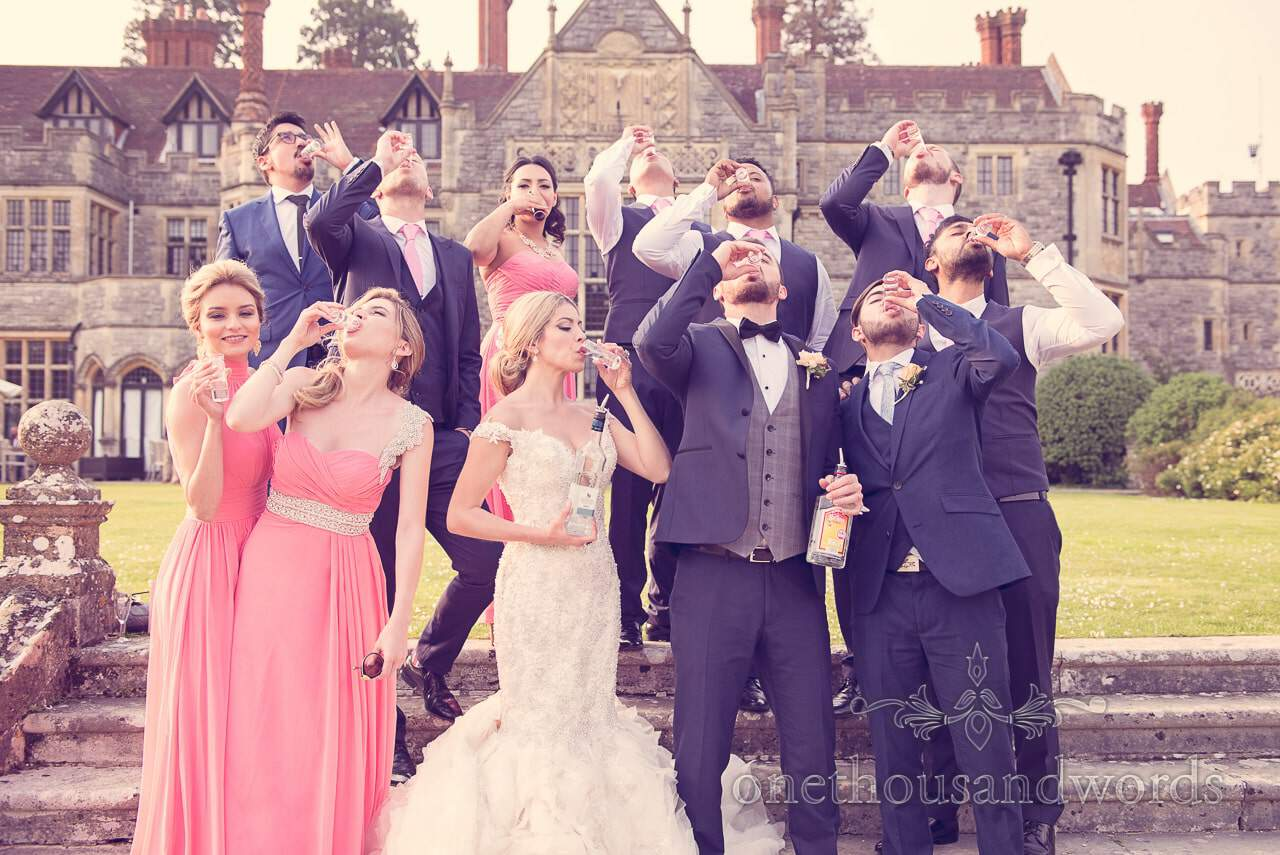 Wedding party drinks tequila at Rhinefield House Wedding venue