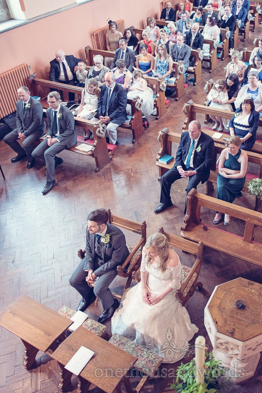 Aerial photograph of Bride and groom and wedding guests in Catholic church