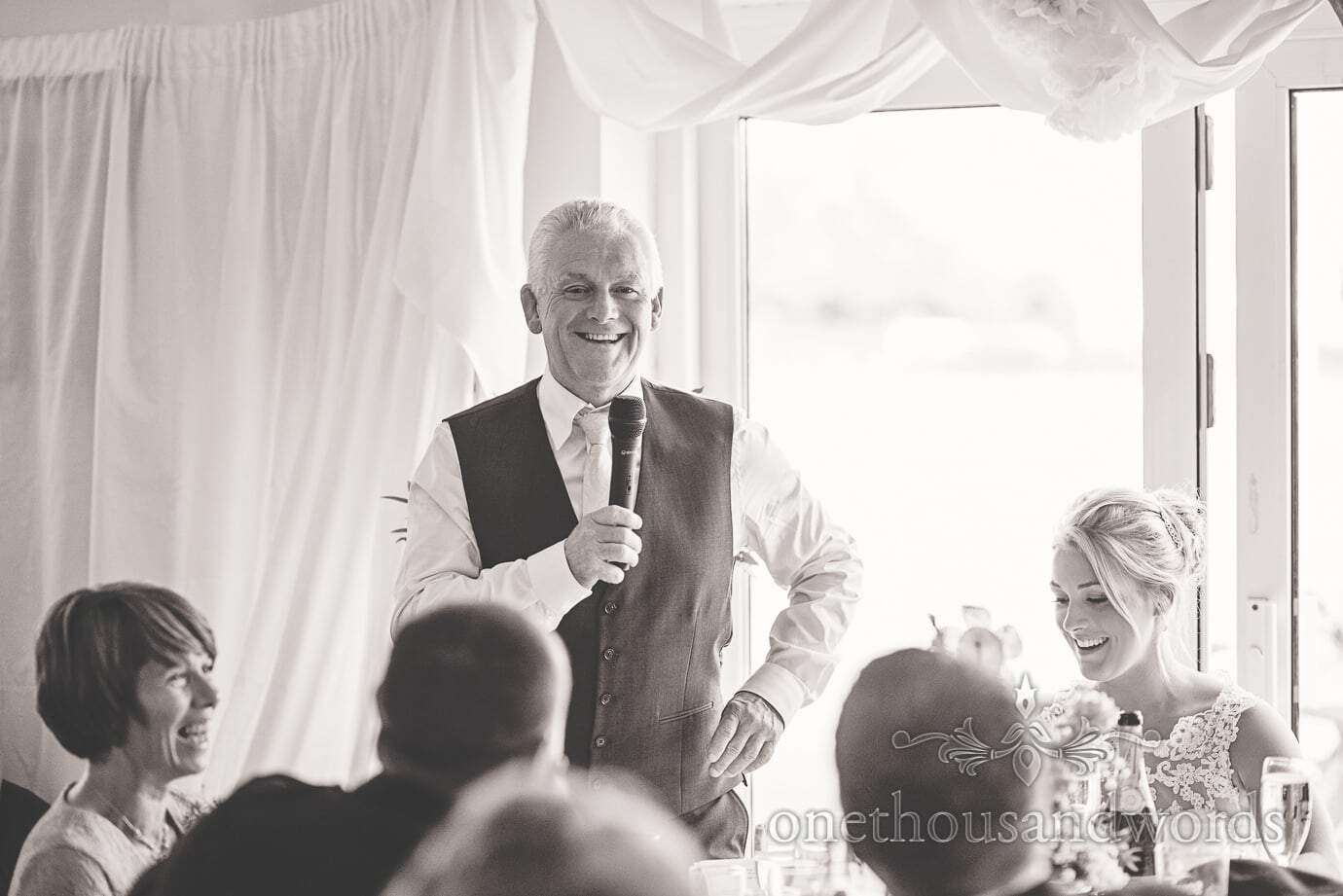 Black and white wedding photograph of father of the bride's speech