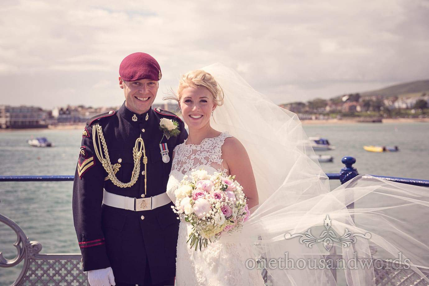 Bride and Groom in military uniform wedding photograph on Swanage pier