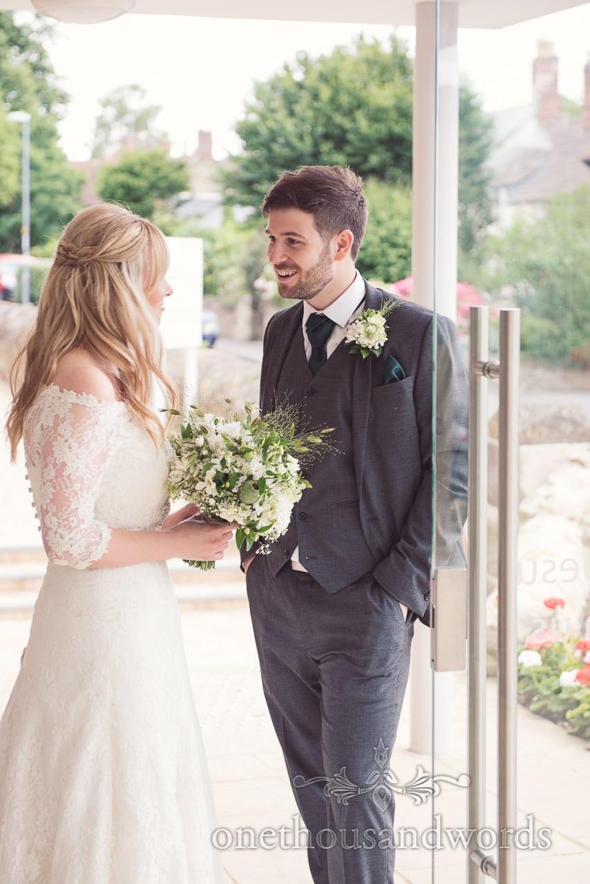 Bride and groom wedding portrait in church doorway in Sherborne, Dorset