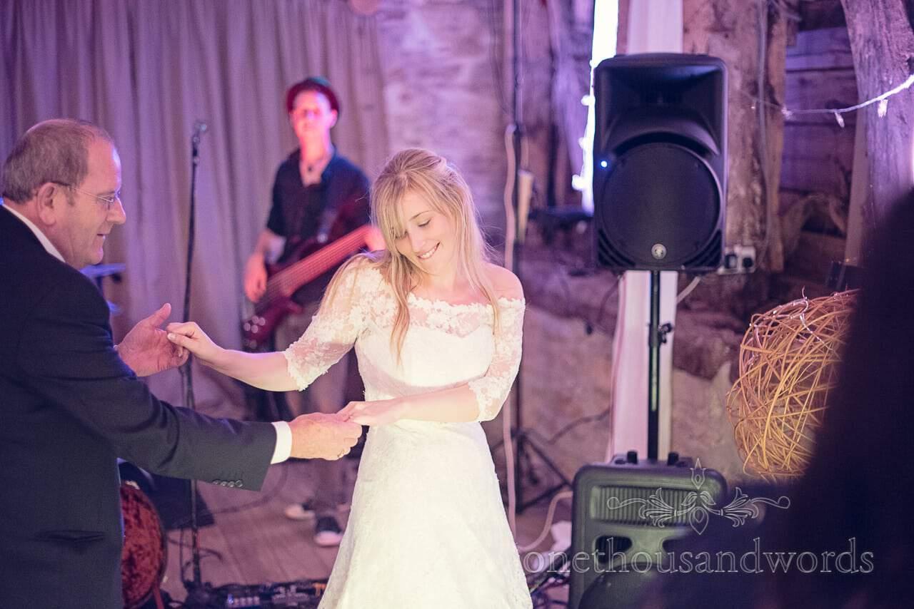 Bride dances with father of the bride at Stockbridge Farm Barn wedding venue in Dorset