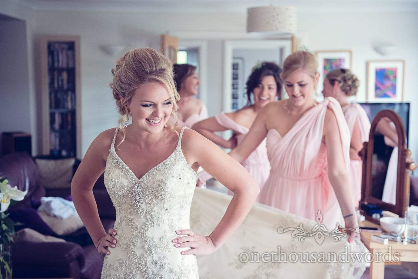 Bride in white wedding dress and bridesmaids in pink greco roman bridesmaids dresses