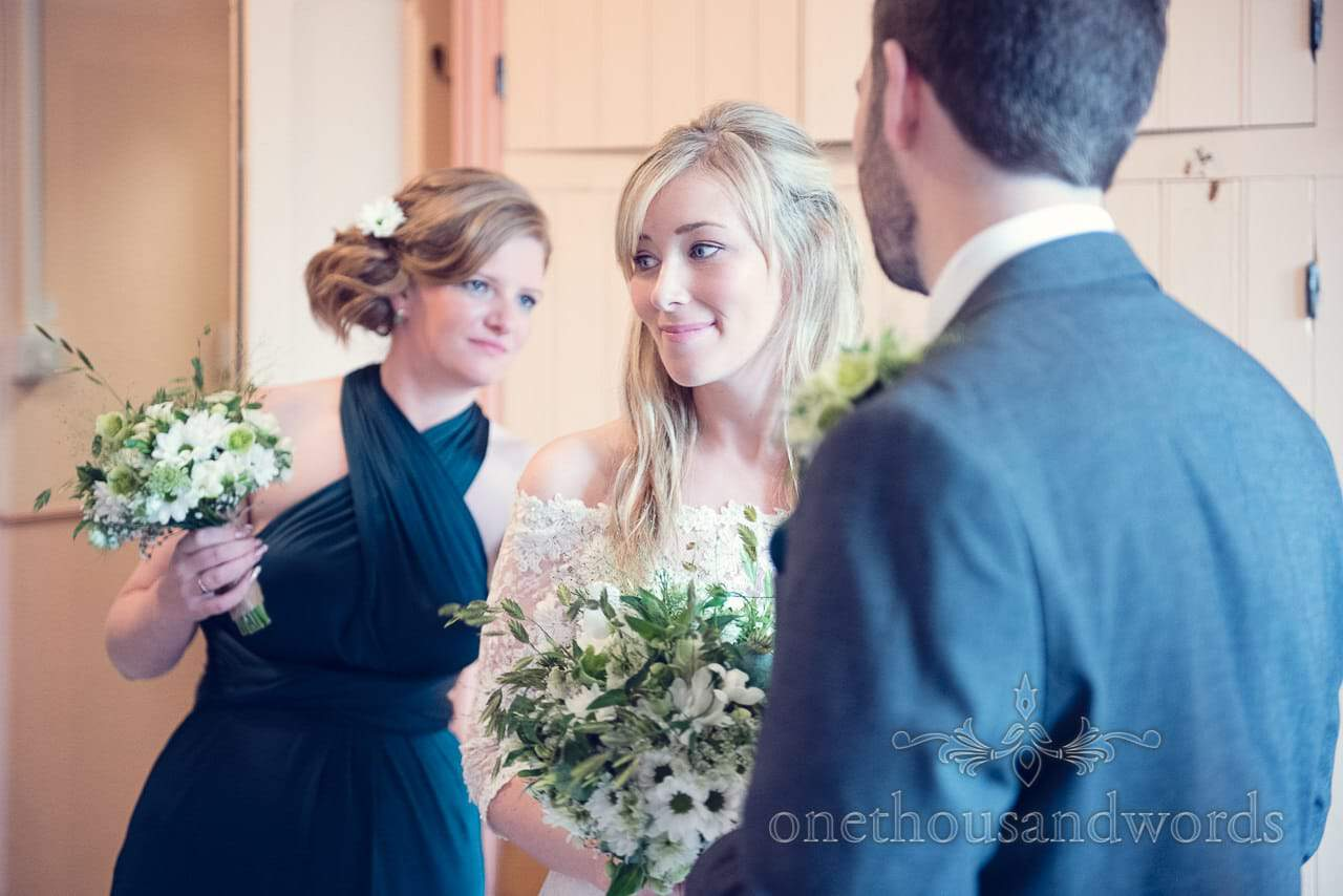 Bride portrait photograph with bridesmaid in emerald green bridesmaids dress