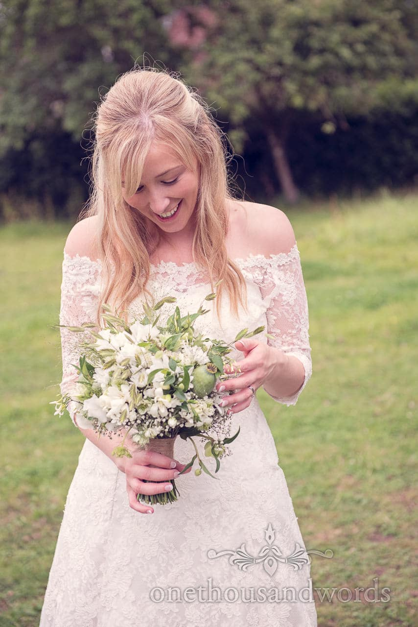 Bride with white and green wedding bouquet at Stockbridge Farm Barn wedding venue