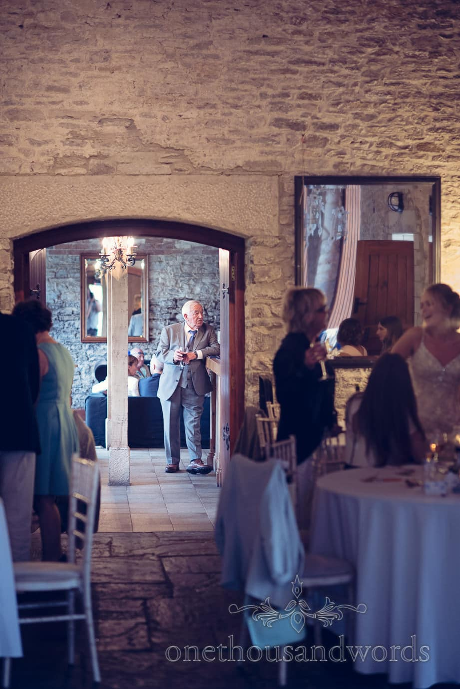 Bride's grandfather at bar at Kingston Country Courtyard Wedding Photographs