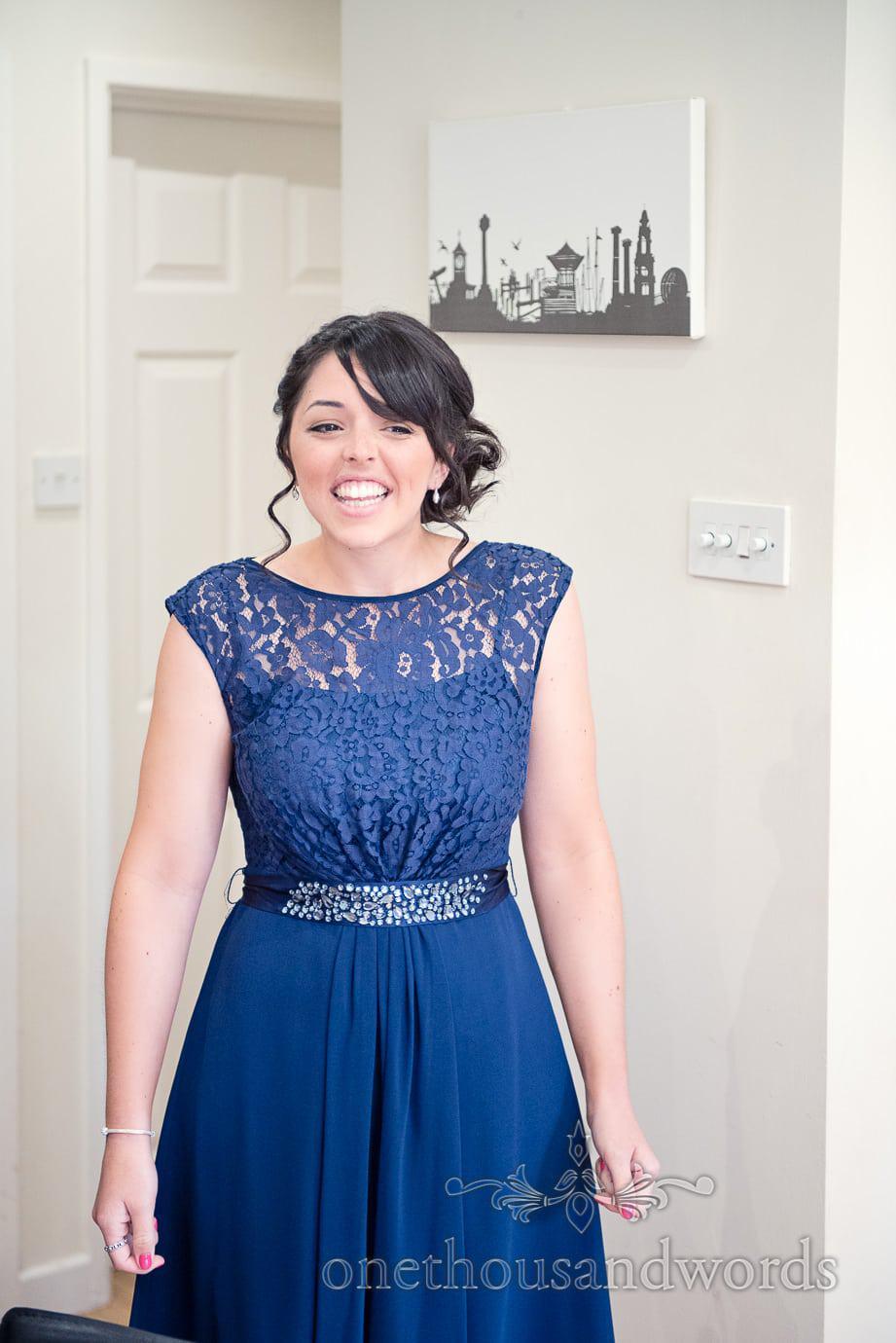 Bridesmaid in detailed blue bridesmaids dress on wedding morning