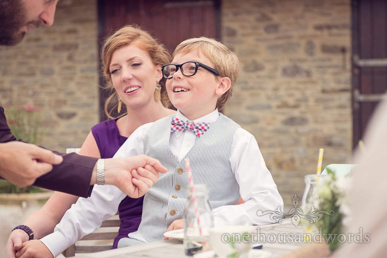 Child wedding guest in bow tie with wedding magician