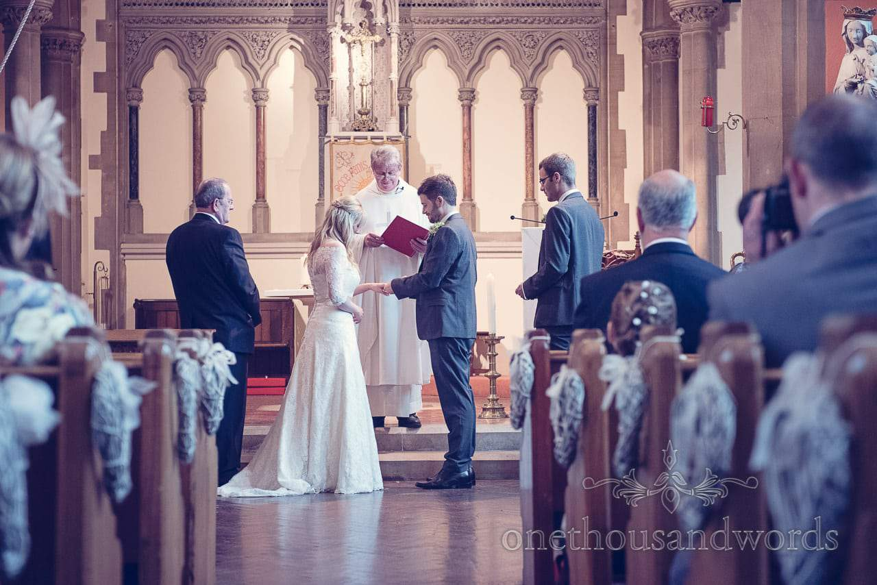 Exchange of the rings at Catholic church wedding ceremony in Sherborne