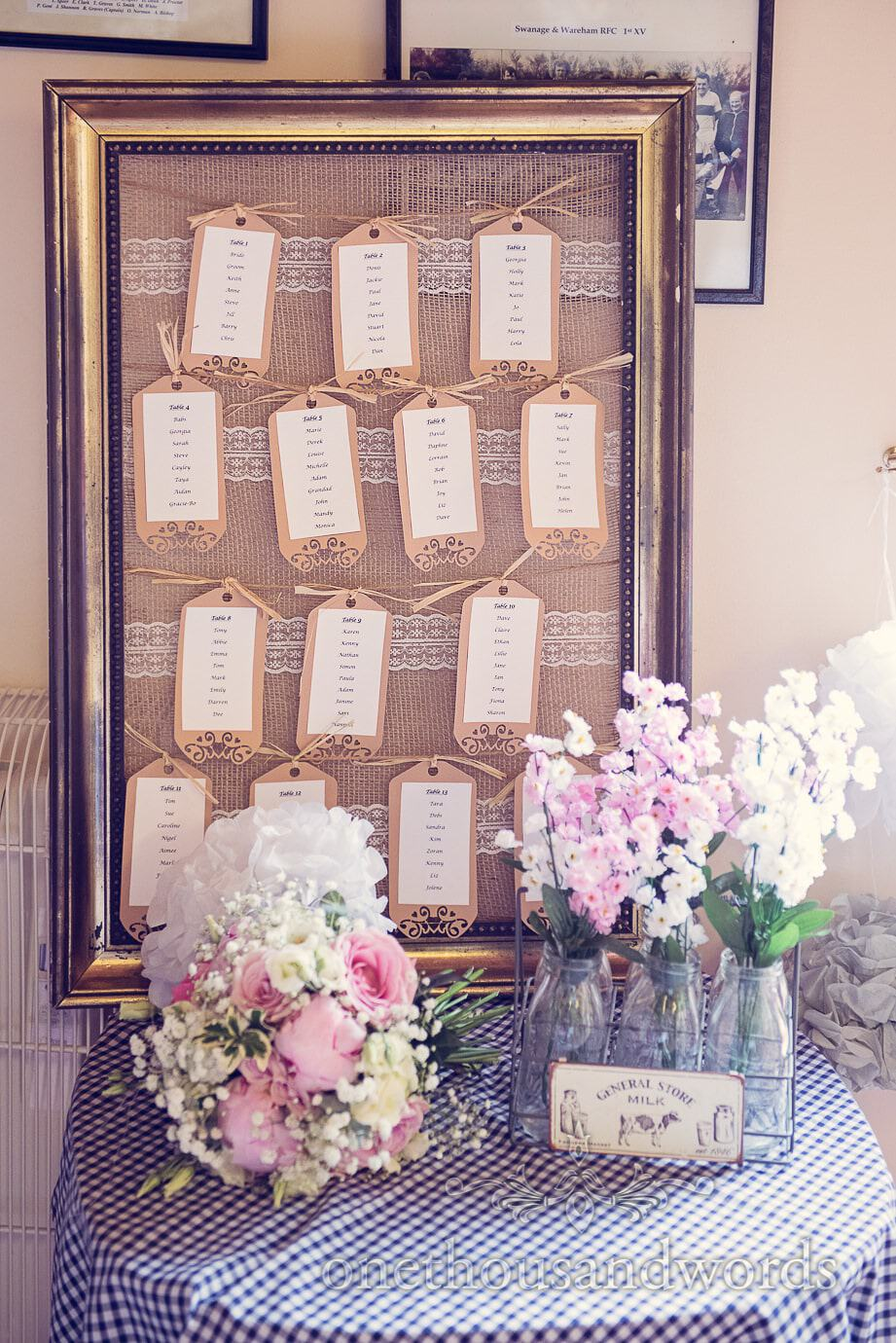 Framed wedding table plan with rustic labels and lace detailing