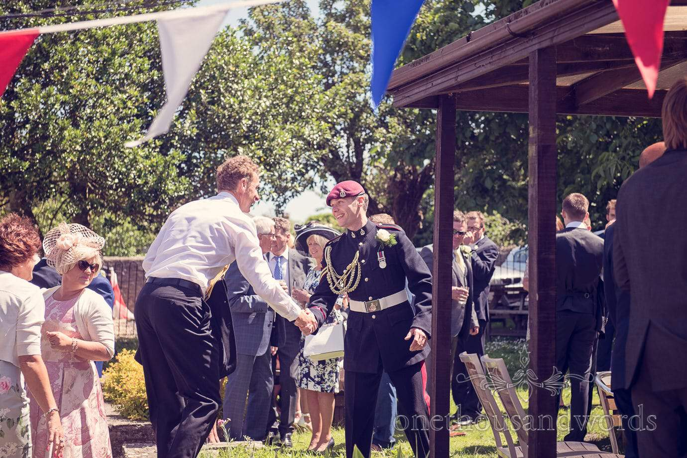 Groom greets guests into Swanage pub garden on wedding morning
