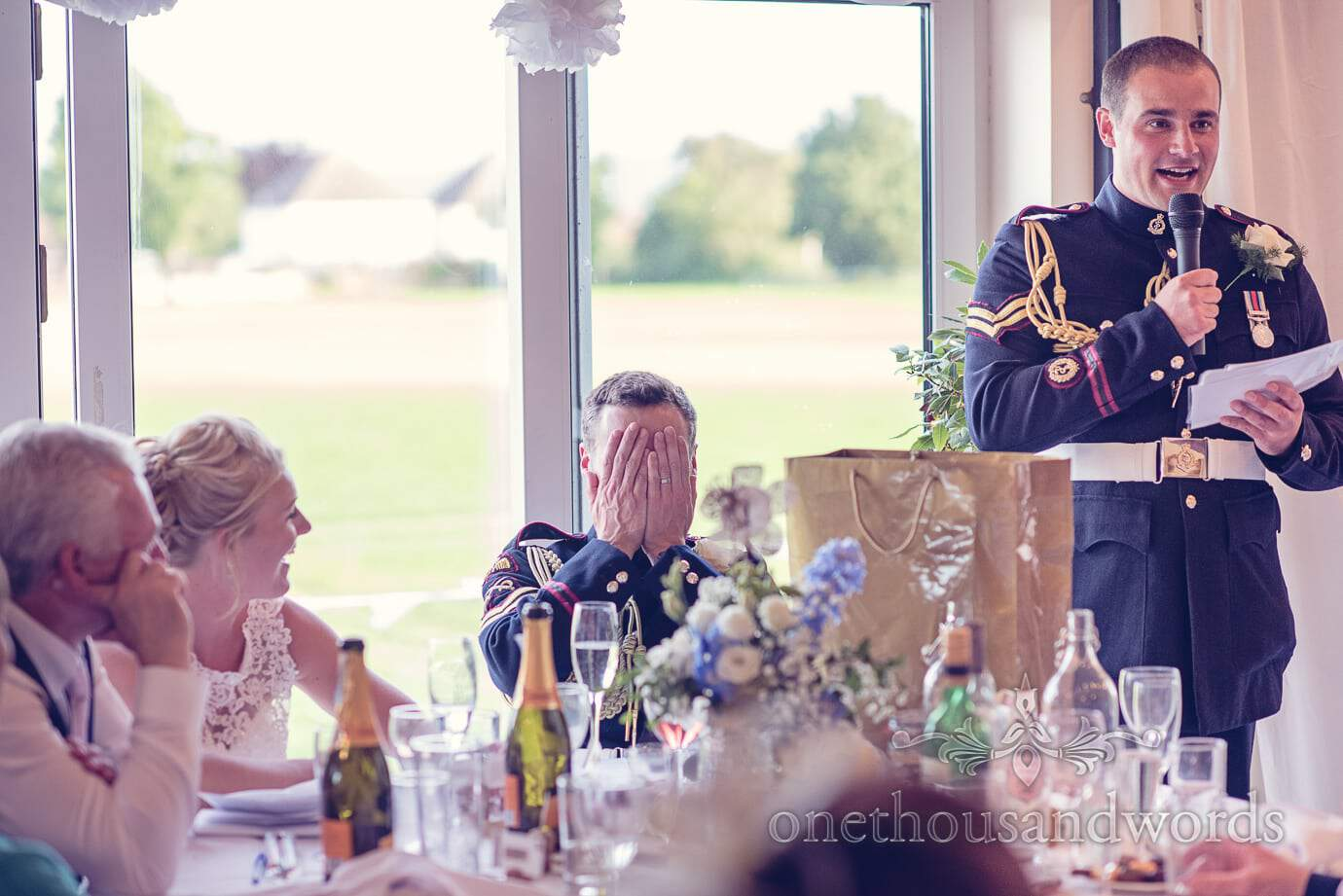 Groom hides his face to Best man's speech at Wareham Rugby Club wedding