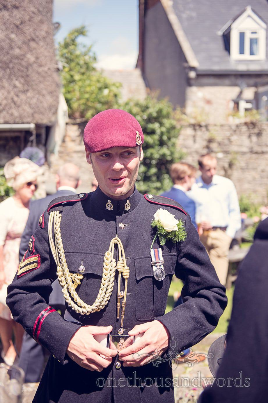 Groom in military uniform calms his breathing in pub garden