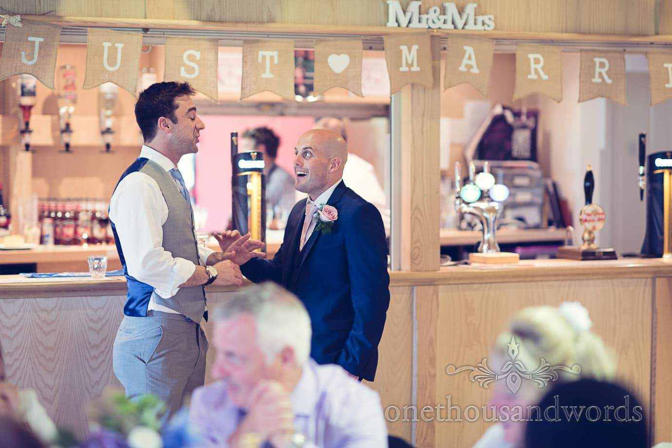 Groomsman and weddign guest at the bar at Wareham Rugby Club Wedding