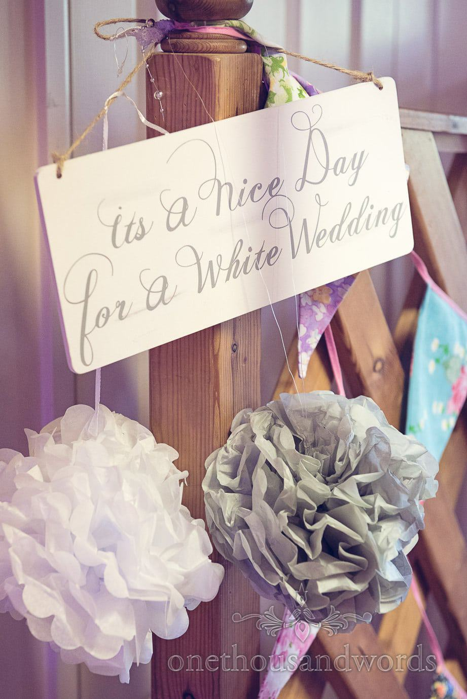 Its a Nice Day for a White Wedding sign with pom poms and bunting