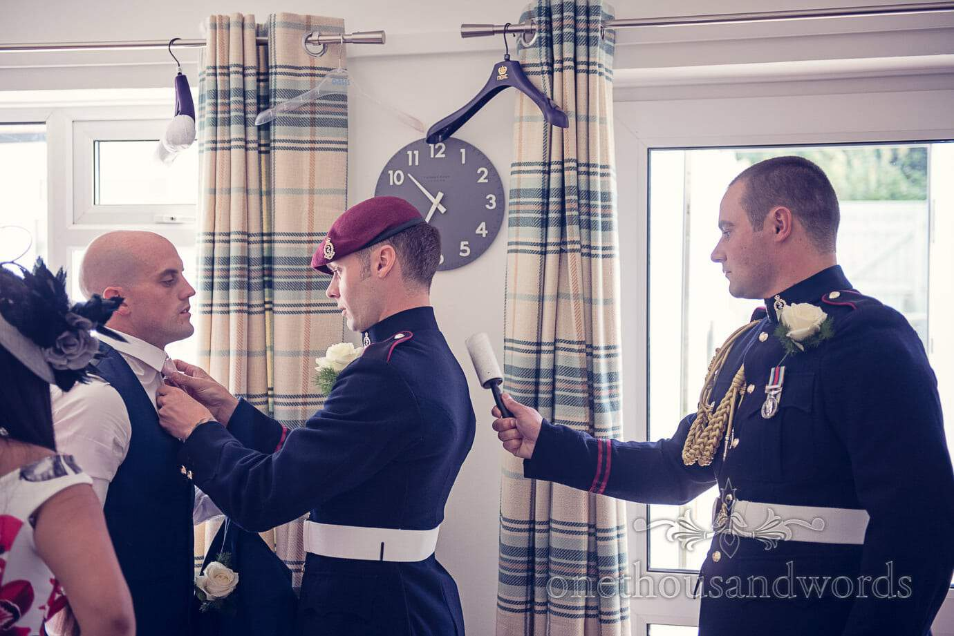 Military groom preparations on wedding morning in Swanage