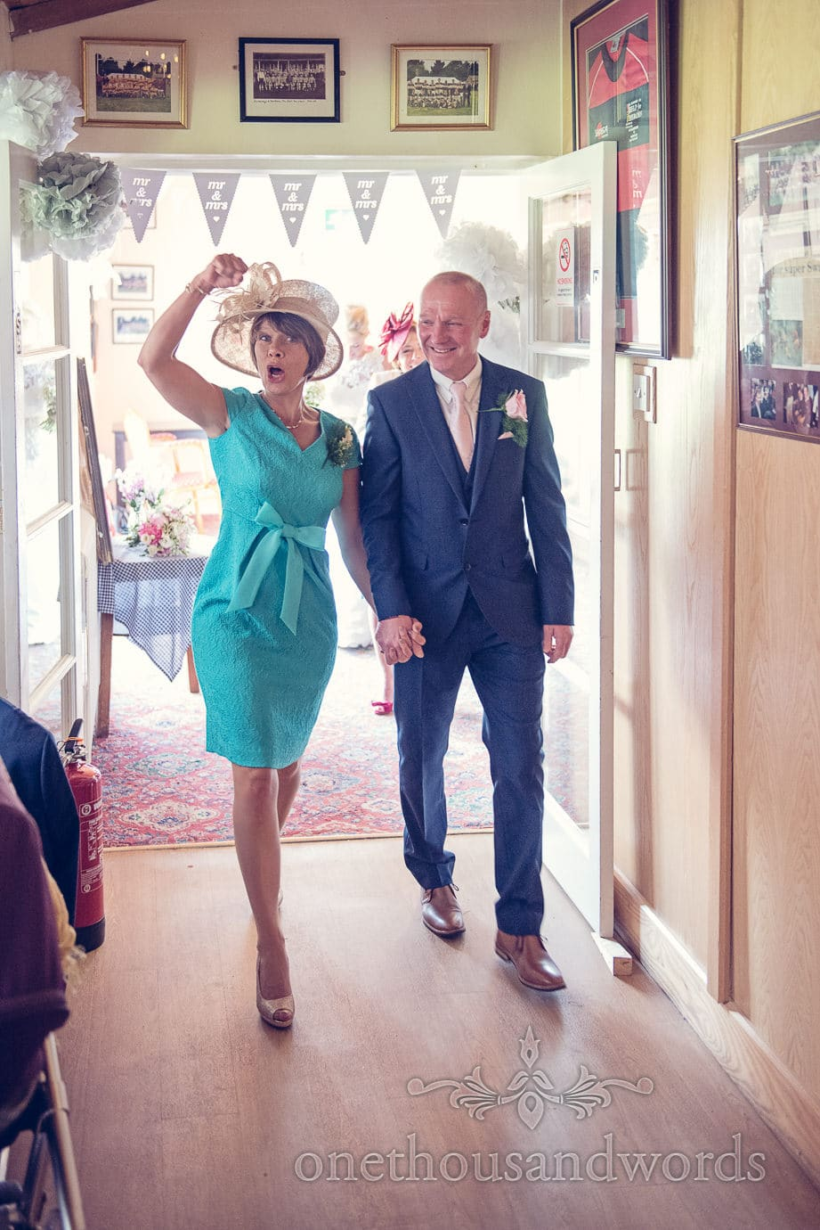 Mother and father of the groom make an entrance to wedding breakfast