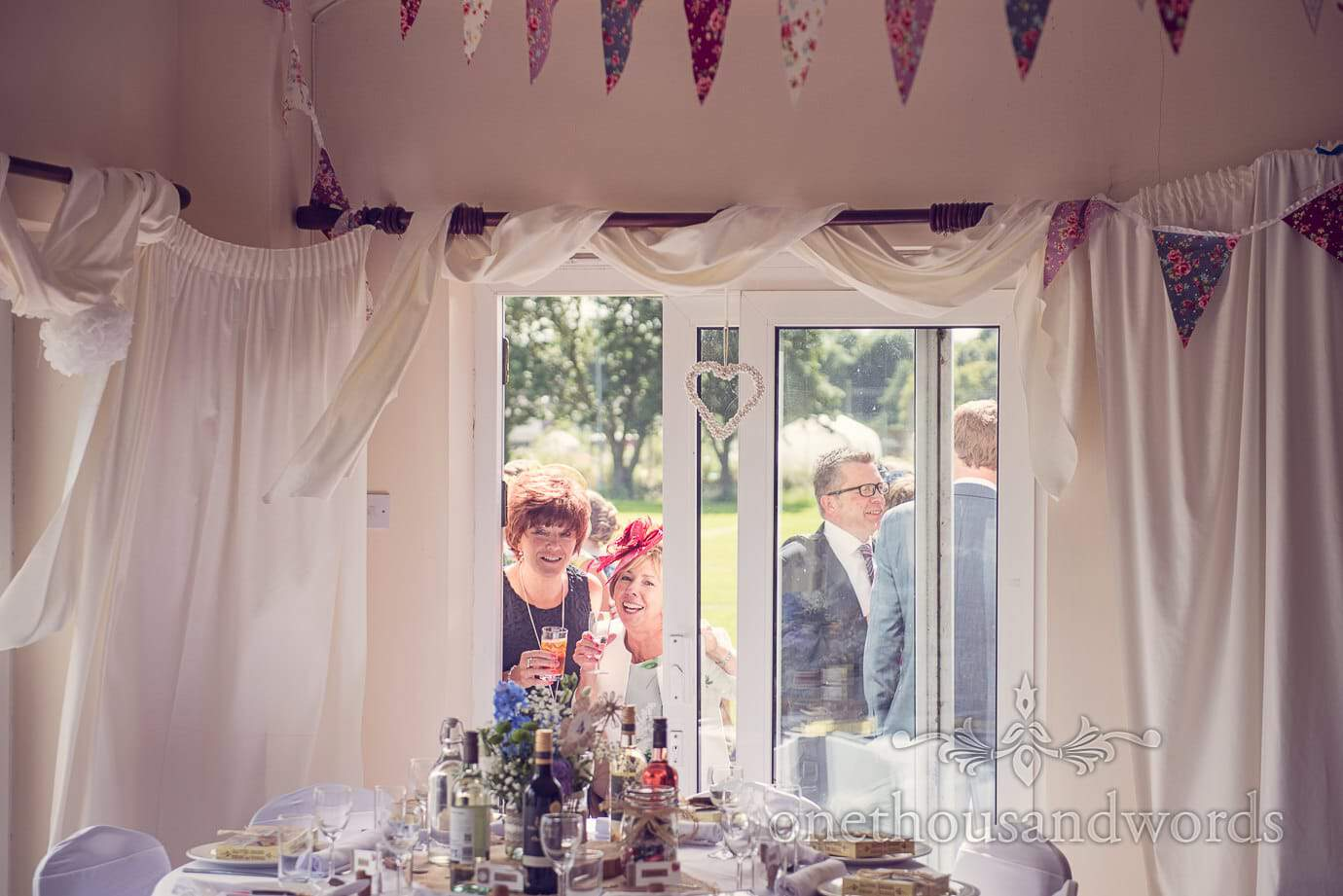 Mother of bride inspects wedding decoration at Wareham Rugby Club wedding
