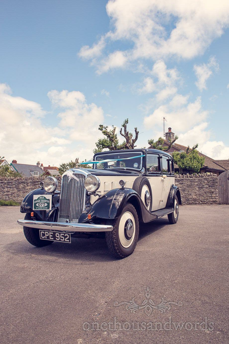 Purbeck Wedding Cars Classic wedding car with ribbons in Swanage