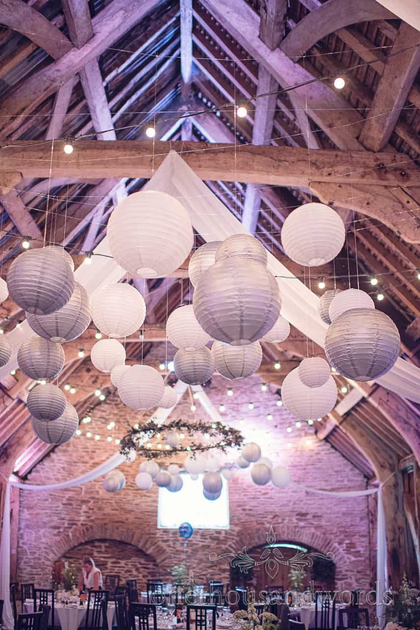 Silver and white chinese lanterns at Barn wedding venue in Dorset