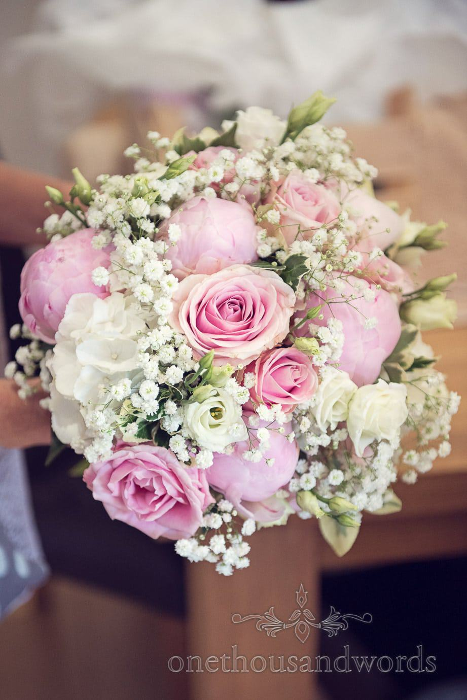 Soft pastel pink and white rose weddign bouquet by Wild Berry Flowers, Dorset
