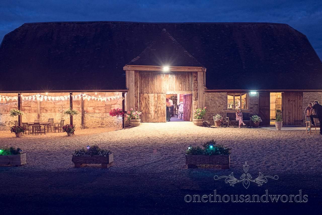 Stockbridge Farm Barn wedding venue in Dorset at night