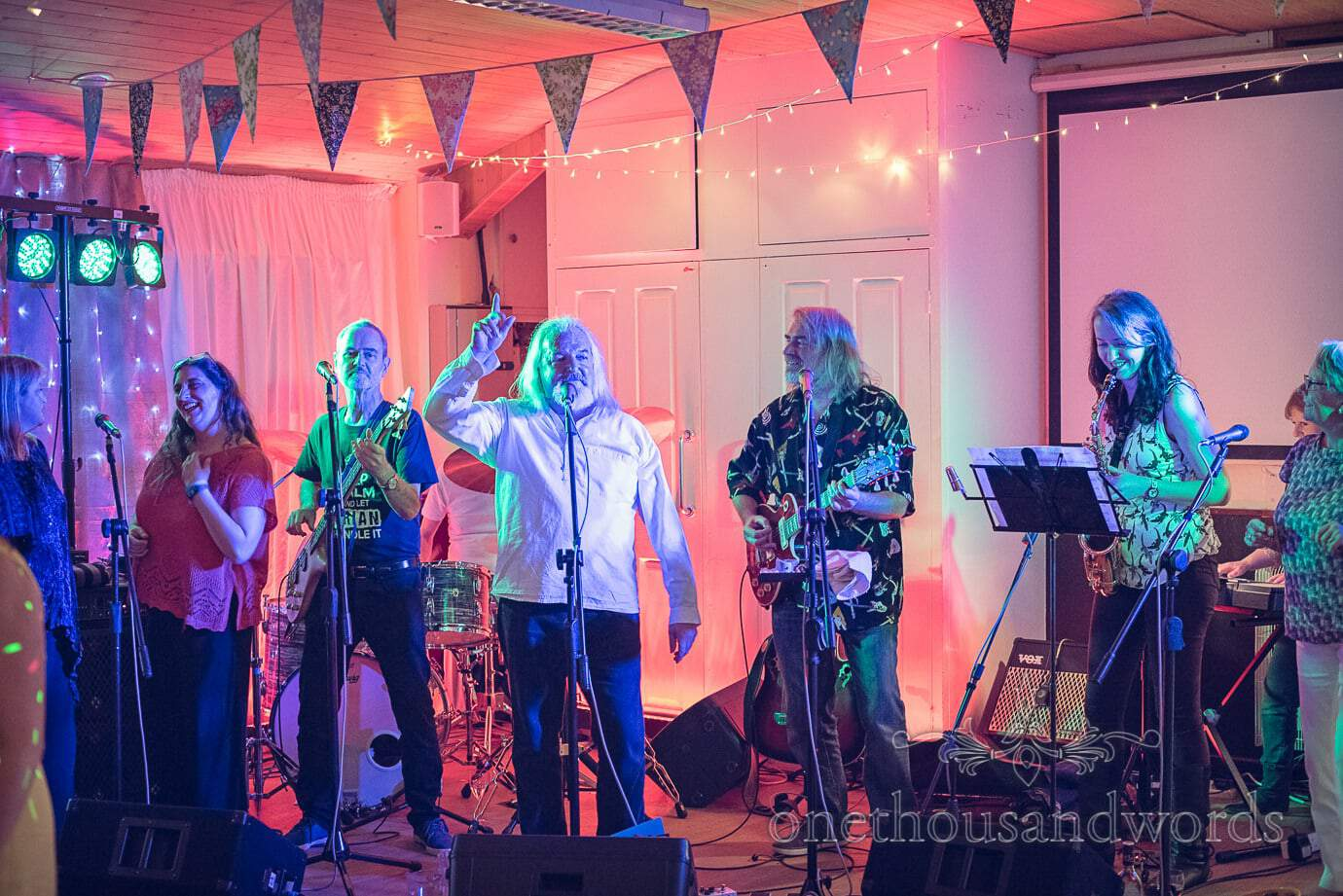 The Reptiles band play Wareham Rugby Club wedding with disco lighting and bunting