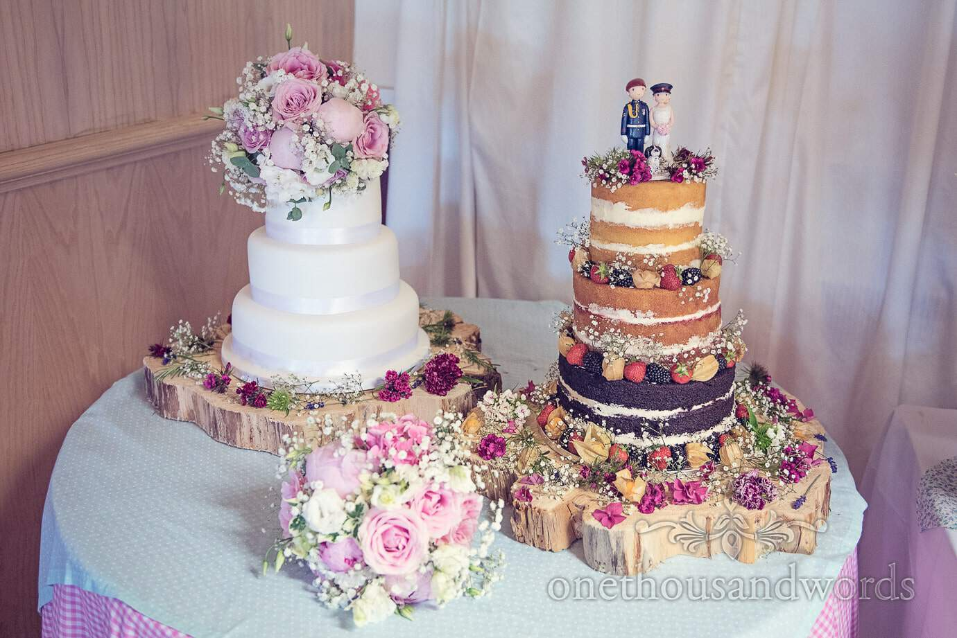 Two different wedding cakes with flowers at one wedding