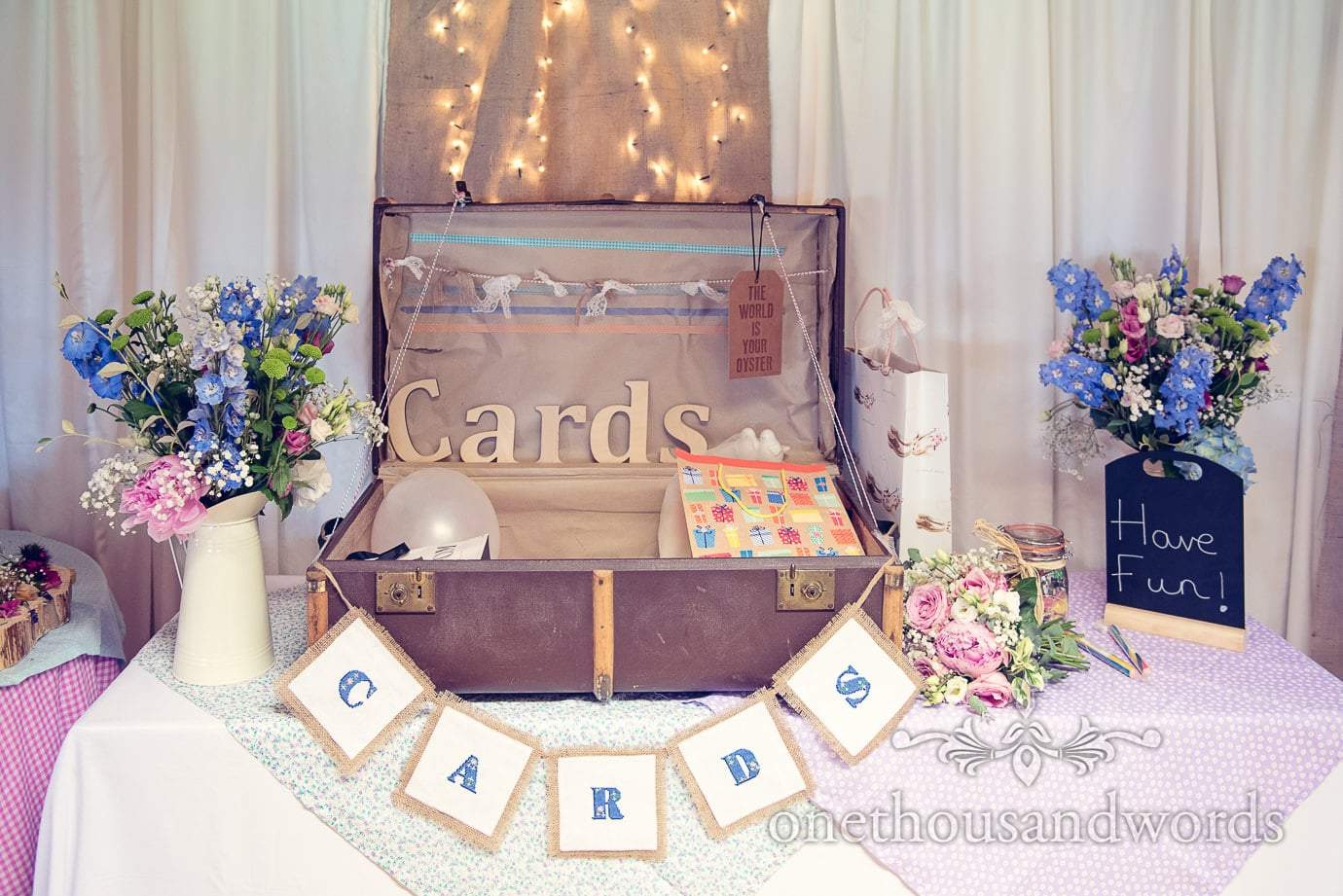 Wedding cards retro suitcase with flowers and fairy lights