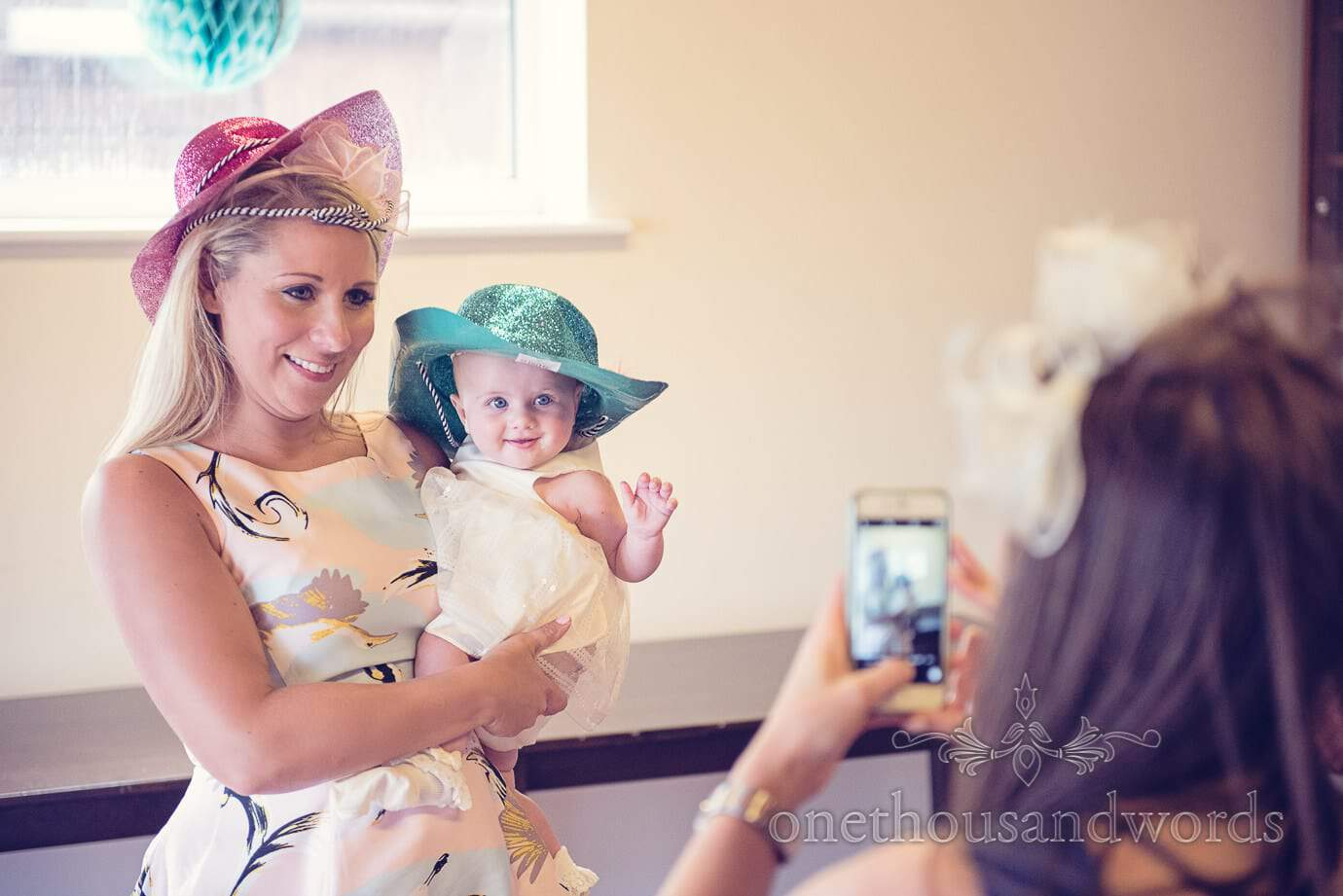 Wedding guest and baby wear colourful sparkly cowboy hats