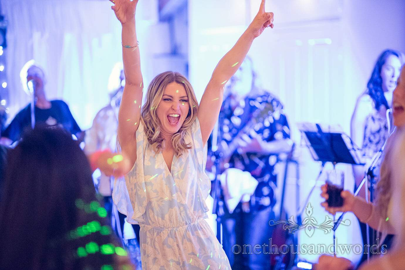 Wedding guest dances with hands in the air at Wareham Rugby Club