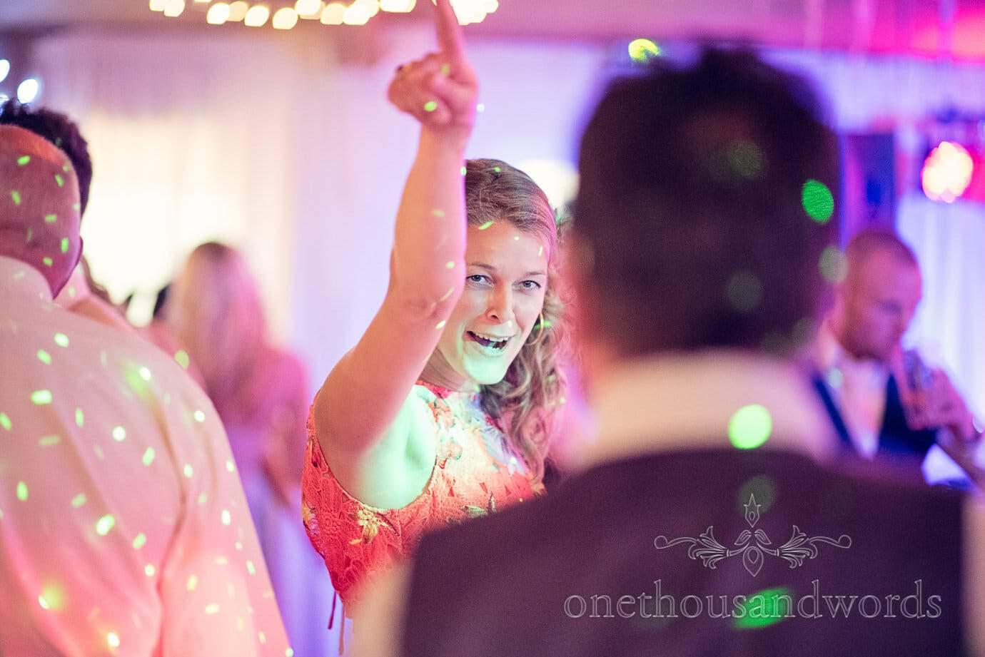 Wedding guest dancing in disco lights at Wareham Rugby Club wedding