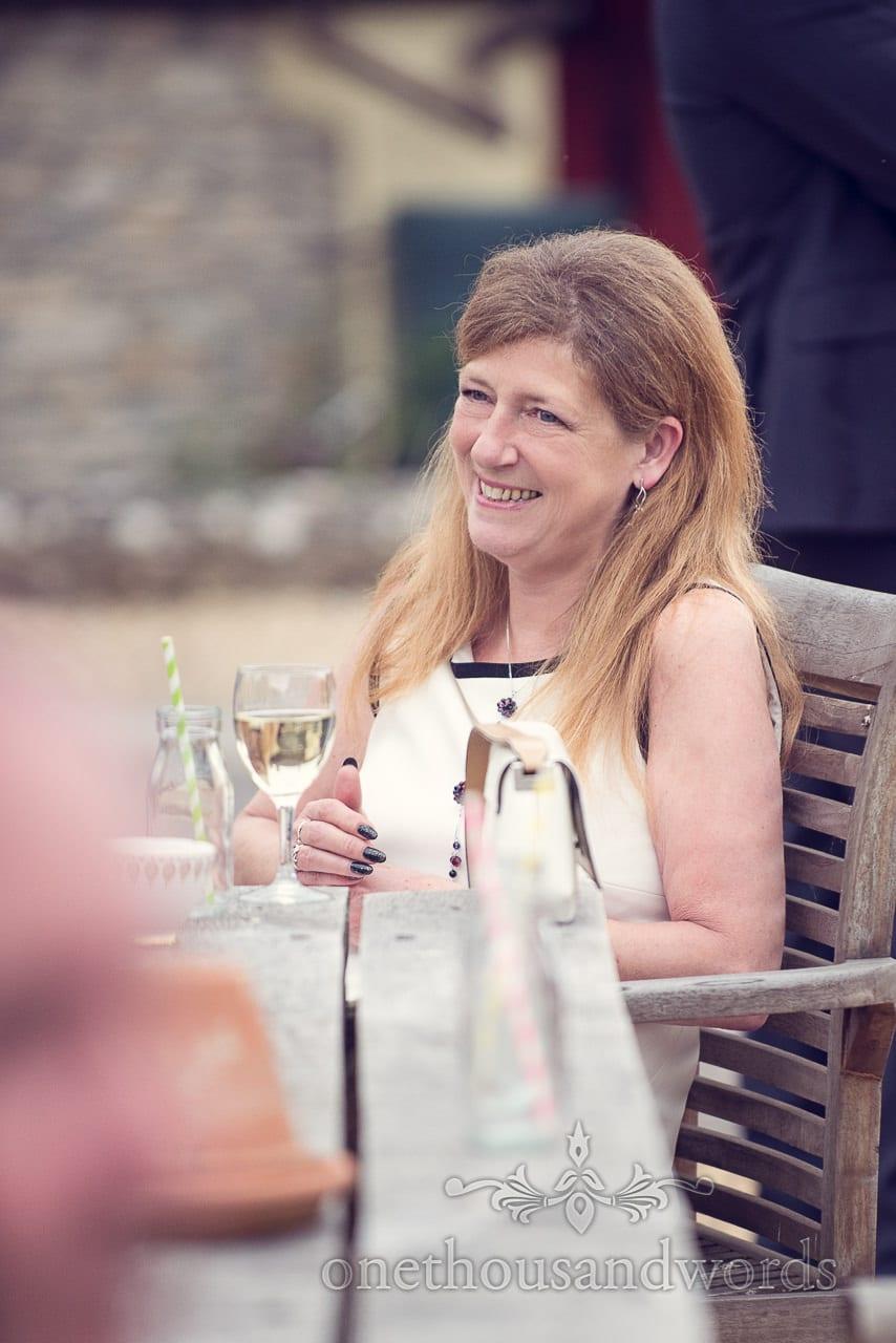Wedding guest portrait during drinks reception at Stockbridge Farm Barn wedding venue