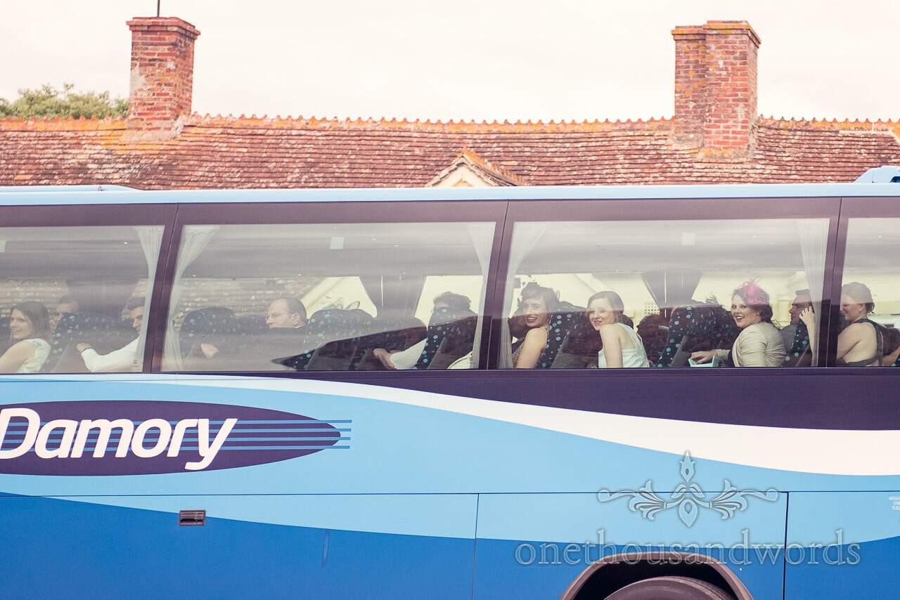 Wedding guests arrive on Damory wedding coach at Dorset barn wedding