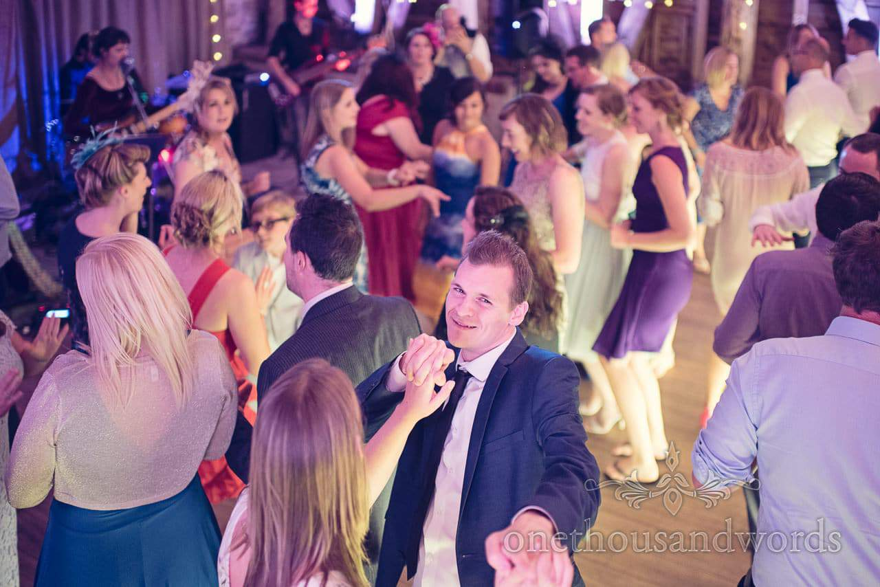 Wedding guests dancing to Sweet and Lowdown wedding band at Barn wedding venue