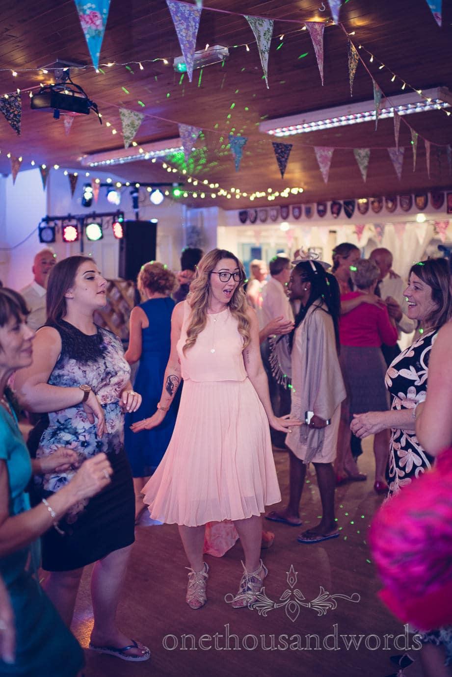 Wedding guests dancing under bunting at Wareham Rugby Club Wedding