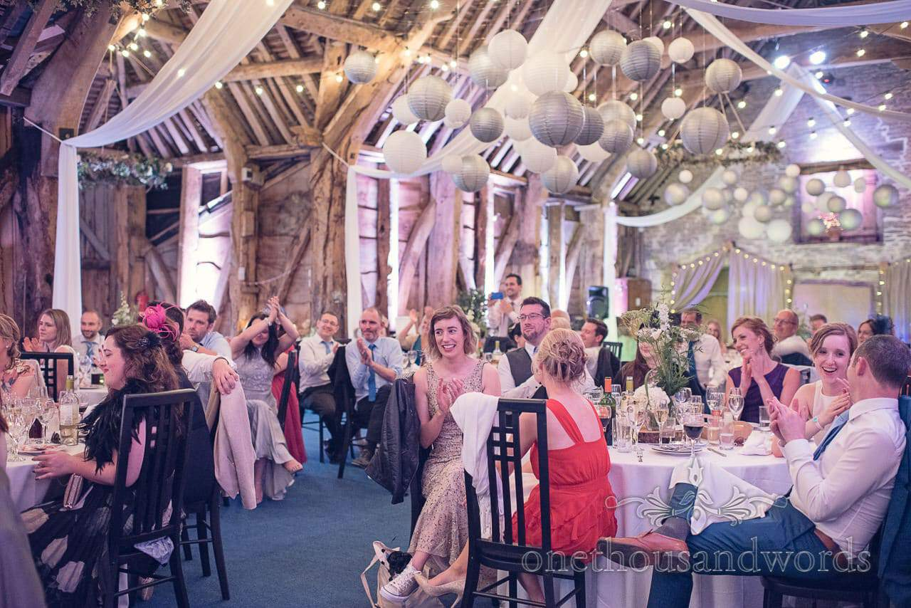 Wedding guests during speeches at Stockbridge Farm Barn wedding venue in Dorset