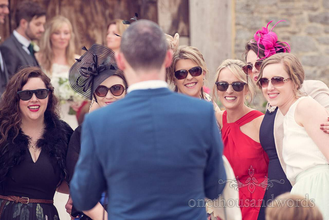 Wedding guests in sunglasses at Stockbridge Farm Barn wedding venue in Dorset