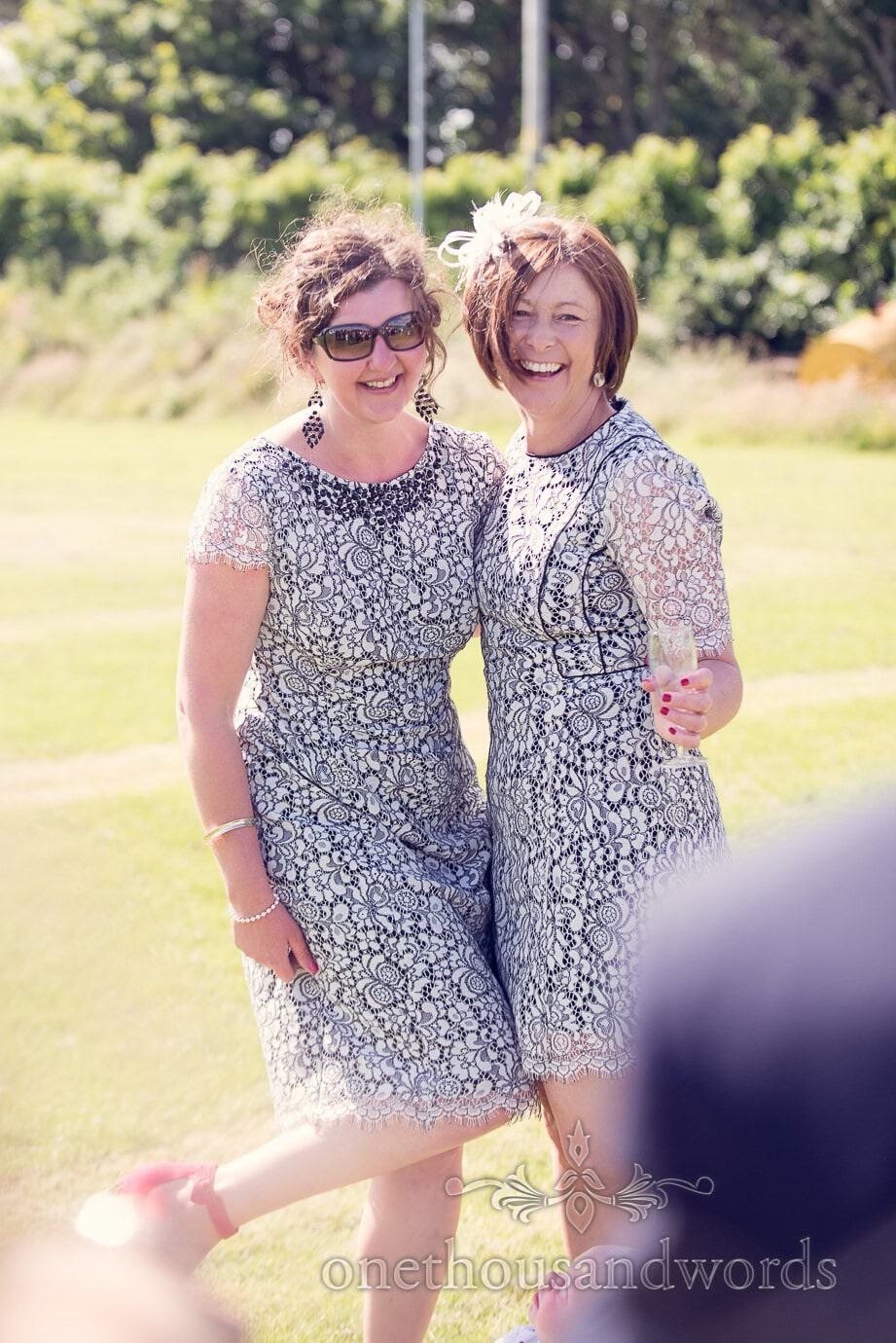 Wedding guests in very similar black and white dresses