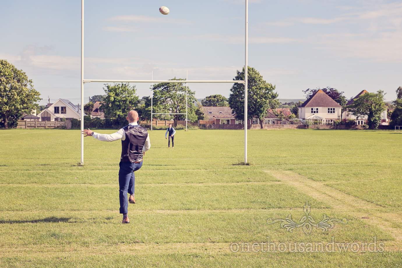 Wedding guests kick rugby ball over posts at Wareham Rugby Club Wedding