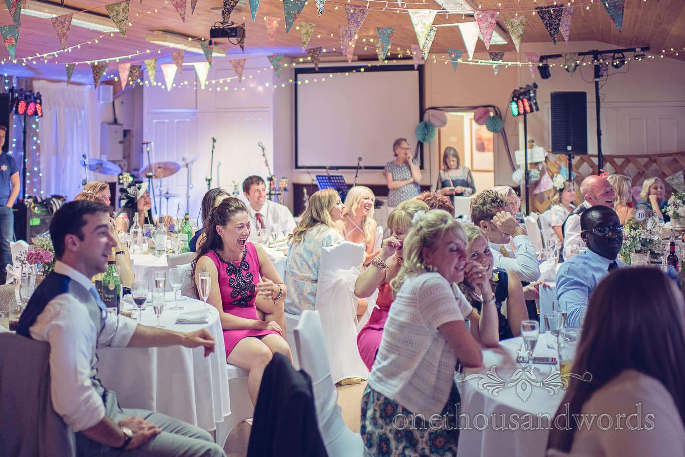 Wedding guests laugh at speeches at Wareham Rugby Club wedding