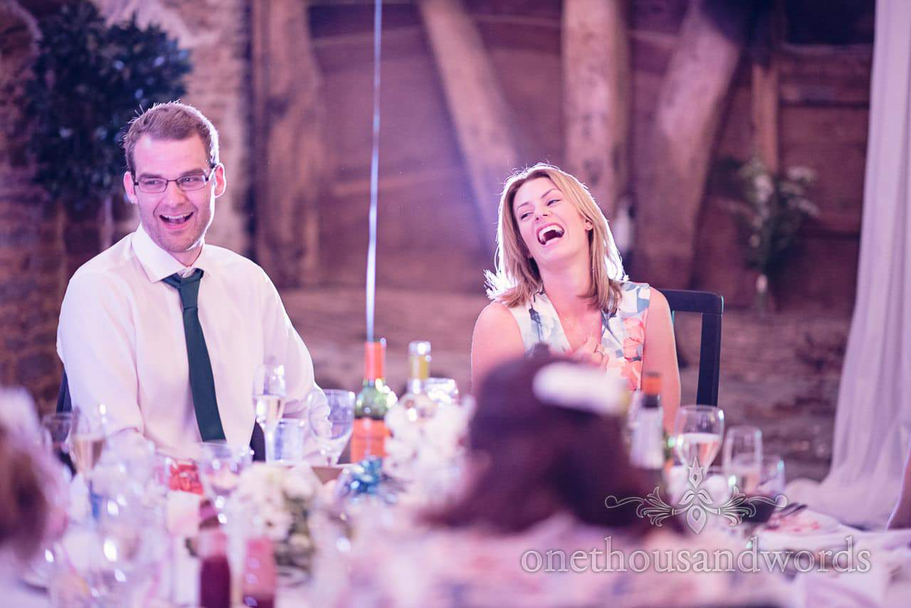 Wedding guests laugh during wedding speeches at Barn wedding venue in Dorset