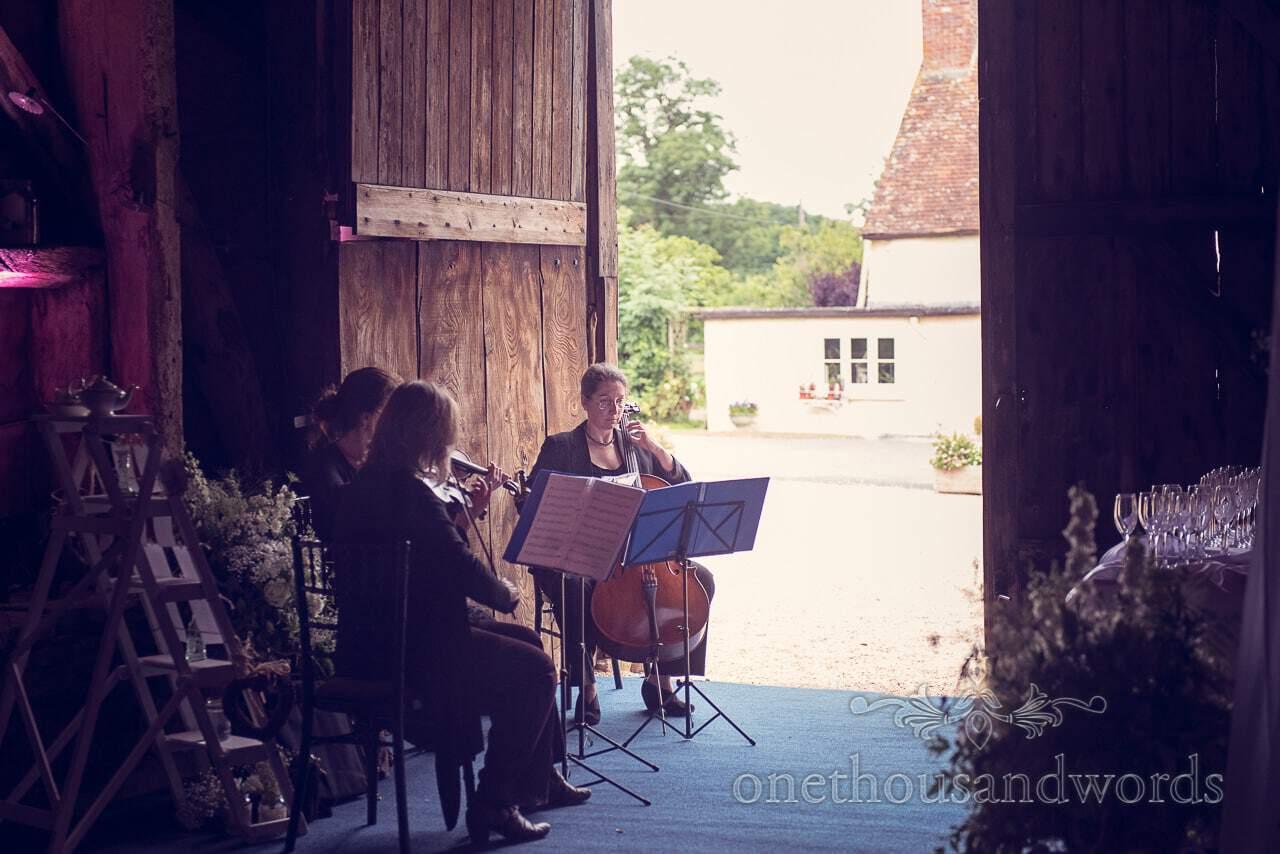 Wedding strings trio play music at Stockbridge Farm Barn wedding venue