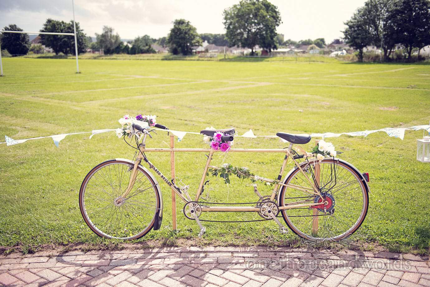 Wedding tandem bicycle with flowers and buting at Wareham Rugby Club