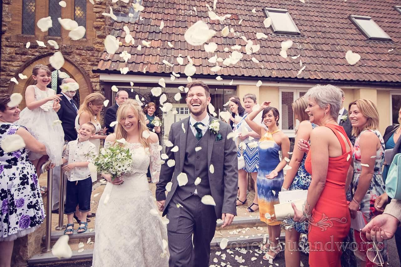 White petal wedding confetti outside church in Sherborne, Dorset