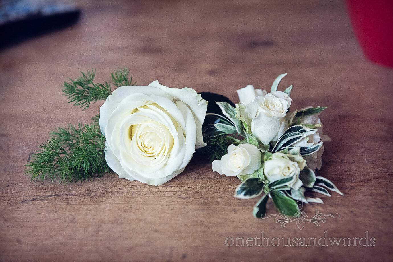 White wedding button hole and corsage by Wildberry Flowers, Dorset