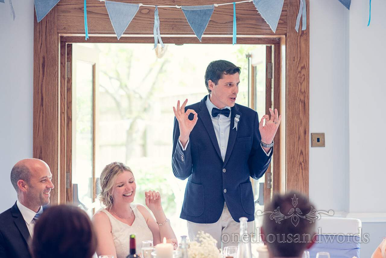 Animated groom's speech with blue bunting at Balmer Lawn Hotel Wedding