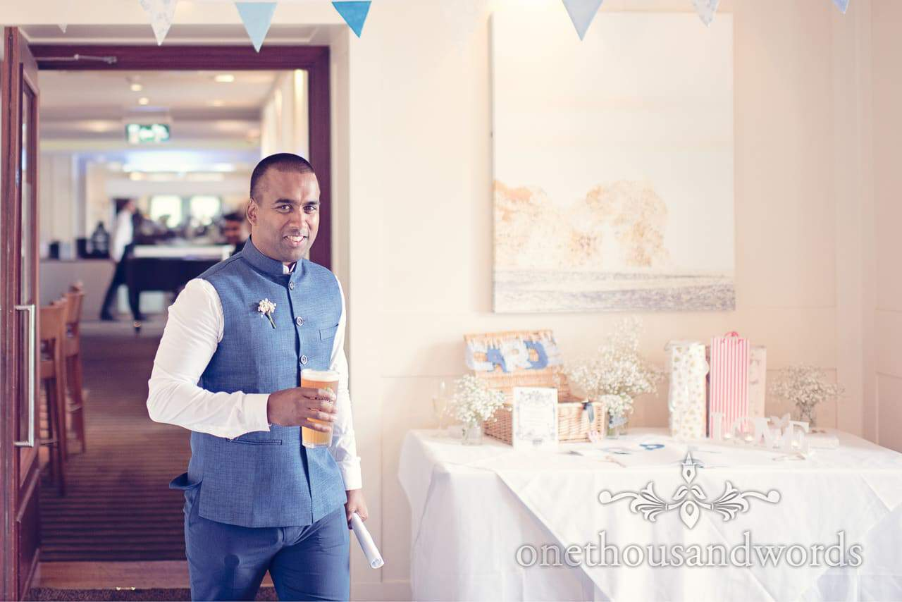 Best man e sleveless suit with cards table at Harbour Heights Hotel Wedding