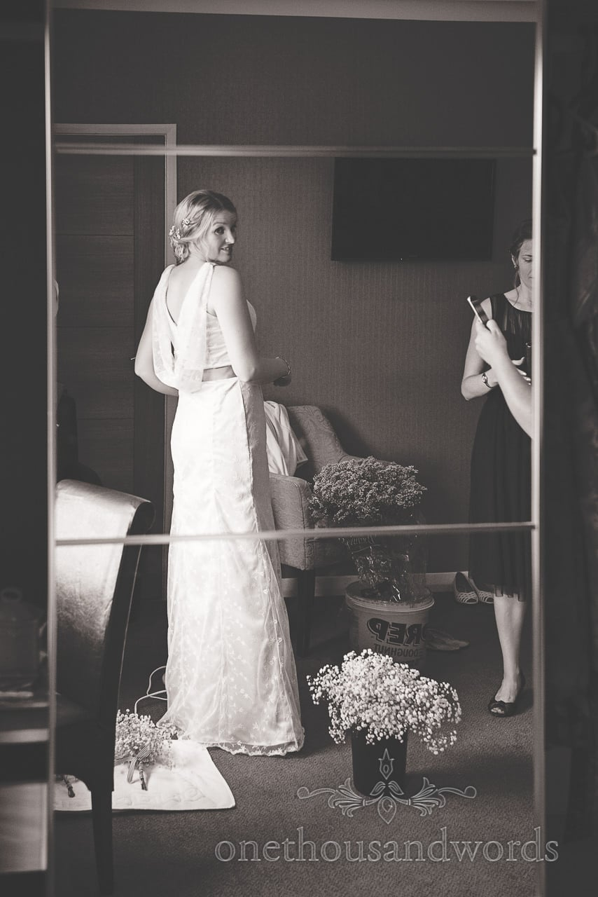 Black and white photograph of bride in handmade wedding dress that she made