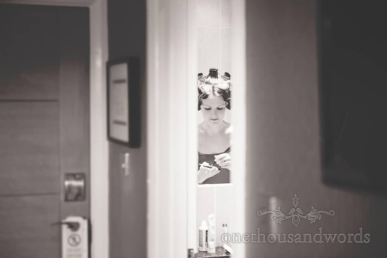 Black and white photograph of bride in mirror preparing for Balmer Lawn Hotel Wedding